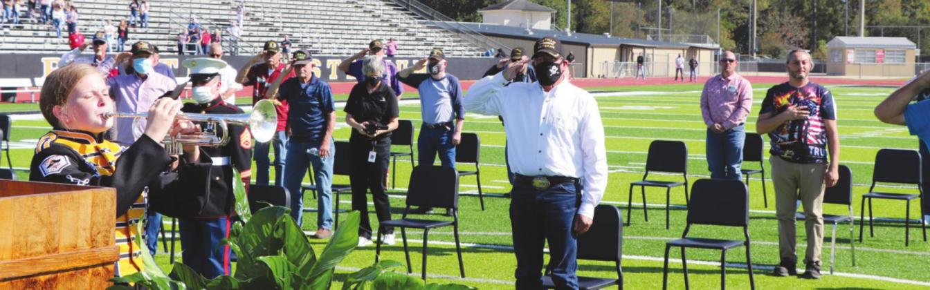 Olivia McWherter played TAPS while veterans saluted.