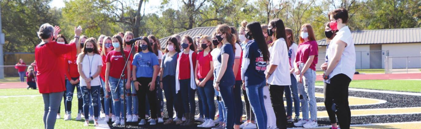 The Vidor Junior High choir performed two pieces, including the service medley, in which all veterans were asked to stand when their branch of service's song was sung.